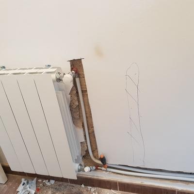 Instalación calefacción en portada con multicapa
