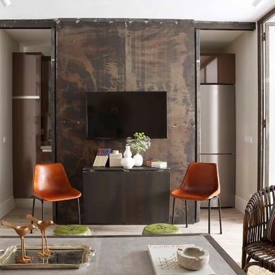 Reforma en C/ Velázquez:  una vivienda que combina hierro, madera y hormigón