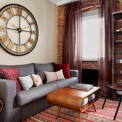 Un apartamento de estilo industrial que combina lo mejor del microcemento y el ladrillo