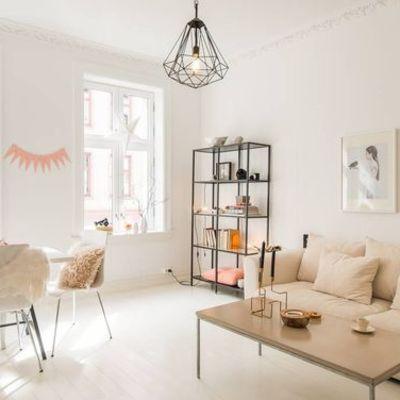 Salón estilo nórdico con detalles en rosa