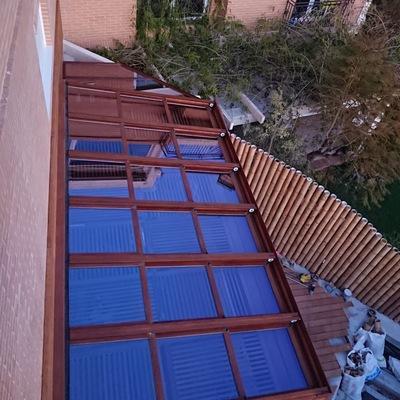 Techo Movil iImitacion madera con cristal climalit 4/10/4+4 protecion solar y cortinas de cristal imitacion madera con cristal protecion solar hd60