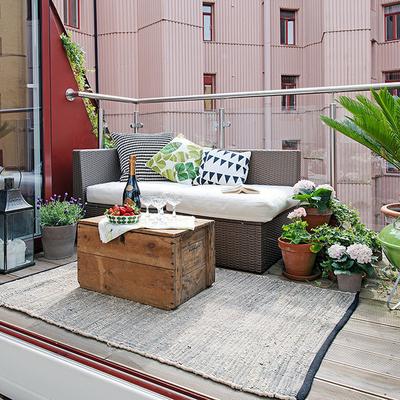 Terraza con alfombra