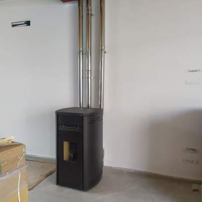 Calefacción estufa pellets canalizada