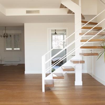 Transformación de escalera de caracol en escalera compensada