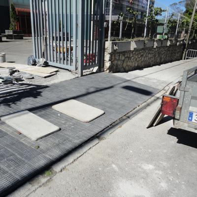 Reparación de acera y asfalto de entrada
