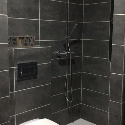 Zona de ducha y vasija
