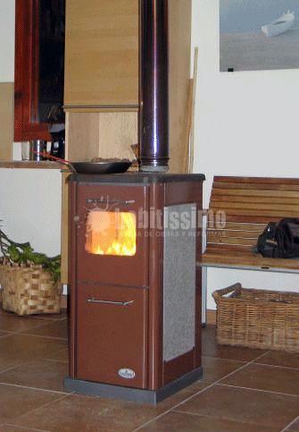 Foto estufa de le a con cocina econ mica instalada en - Cocina economica a lena ...