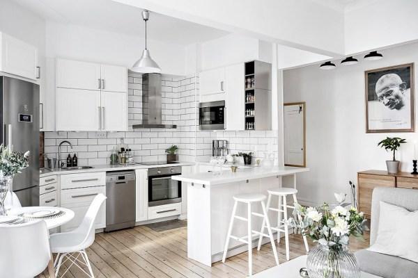 Foto cocina abierta con barra de miv interiores 1317651 for Departamentos decorados en blanco