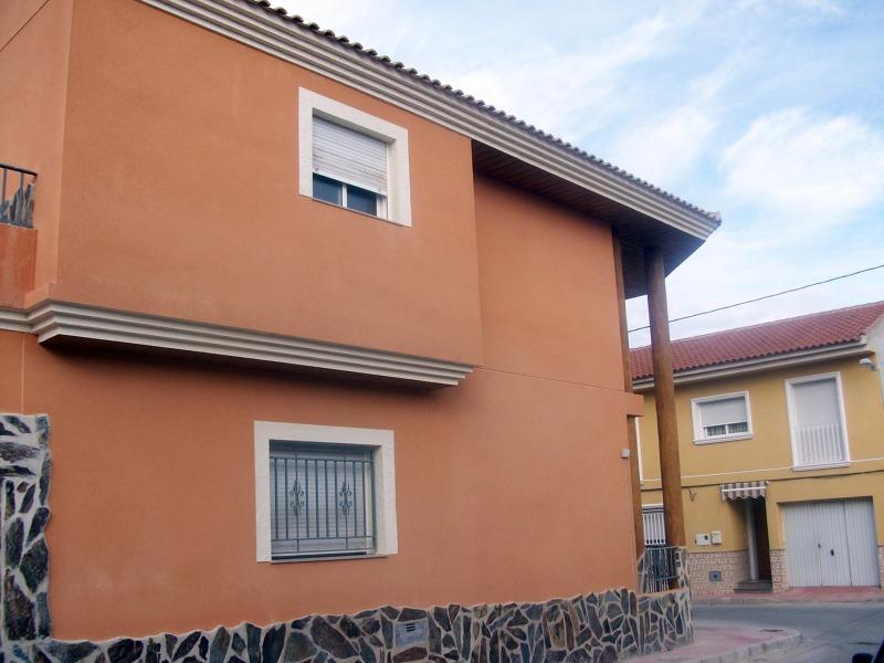 Foto fachada raspado naranja de estucados javier garzon 152497 habitissimo - Colores de fachadas modernas ...