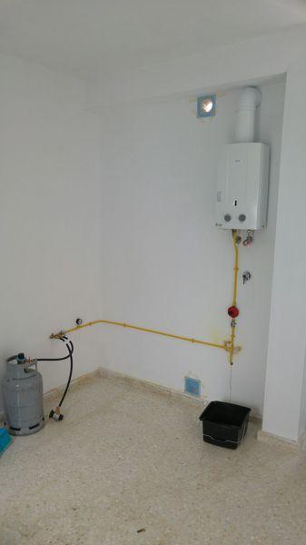 Foto instalaci n de gas y termo de gas de efisolar - Precio termo de gas ...