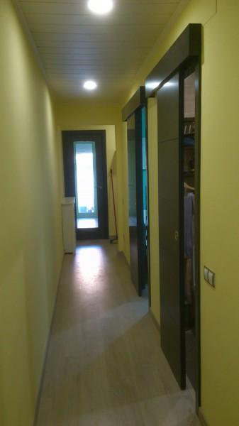 Foto instalacion de puertas parquet y altillo de for Puertas y parquet