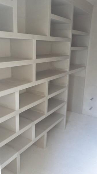 Foto mueble de vestidor a medida en escayola de yesos y - Muebles de escayola para el salon ...