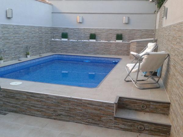 Foto piscina de obra en vivienda unifamiliar de estudio for Piscinas de obra precios