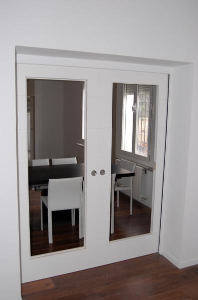 Foto puerta corredera doble de reformad 434365 habitissimo - Correderas para puertas corredizas ...