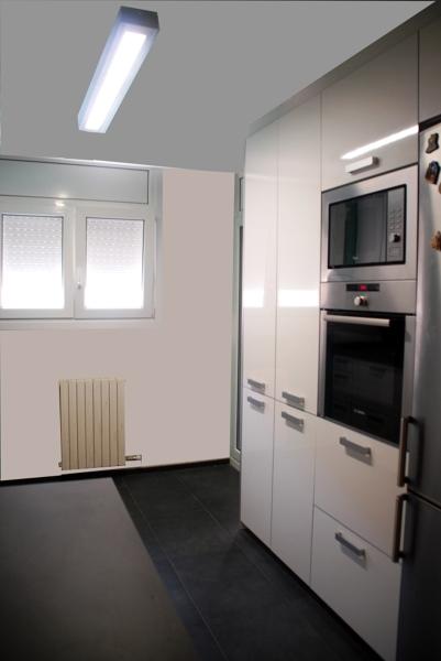 Foto reforma de cocina con mobiliario biforis y encimera - Fotos de reformas de cocinas ...