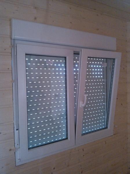 Instalar carpinteria exterior en casa de madera