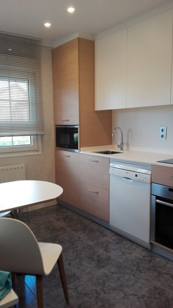vista de reforma cocina ejecutada por contemporánea interiorismo, zona de caldera micro y lavadora