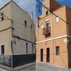 Antes y después de fachada principal de edificio rehabilitado