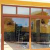 Cerramiento Porche con PVC Roble dorado VEKA
