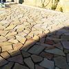 Colocación de solería de piedra natural en zona de piscina