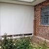 Cortina enrollable de Polyscreen 5% guiada exterior