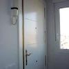 Detalle panelado puerta existente