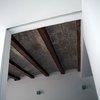 Detalle vigas de madera restauradas