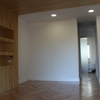 Dormitorio principal, techo de madera con cabecero y baño