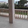 Embaldosado terraza y forro columnas