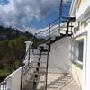 Escalera metálica con terminación madera