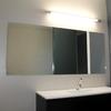 Colgar espejo en baño