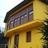 Fachada principal y ventanas nuevas