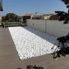Preparar jardín con piedra decorativa