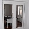 Poner puerta corredera doble empotrada en la pared
