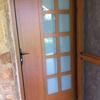 puerta entrada vivienda de aluminio y cristal, con puerta con mosquitera