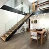 Salón-comedor. Escalera volada y doble altura