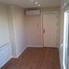 suelo gres,emisores de calor, puerta principal
