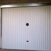 Sustituir muelle de torsión de puerta de garaje
