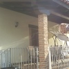 Terraza vigas madera y ladrillo rustico fino