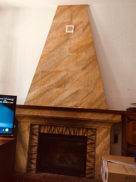 ¿Cómo le doy un cambio a esta chimenea sin mucho gasto?