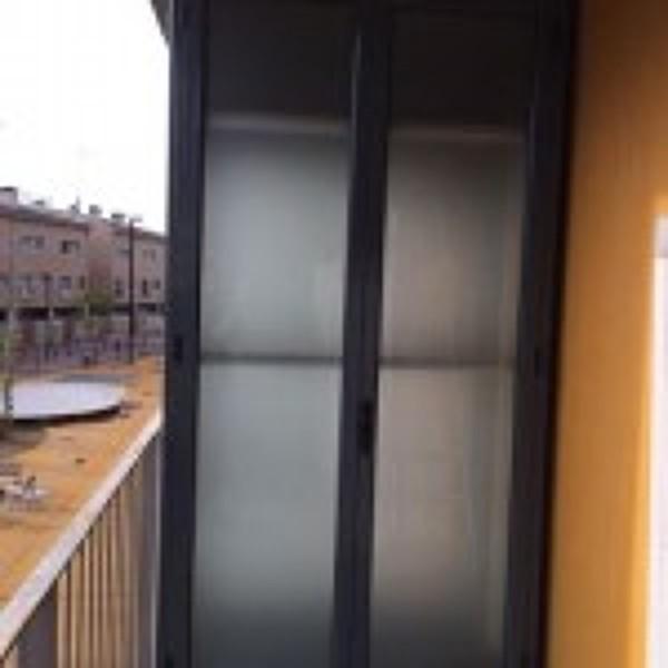Puertas de aluminio exterior precios puertas de interior for Precio montaje puertas interior
