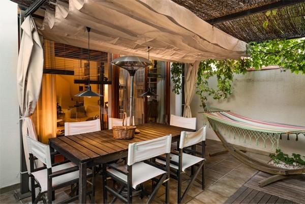 ¿Cuánto costaría un surtidor de agua o cortina de agua en el lateral de la terraza?