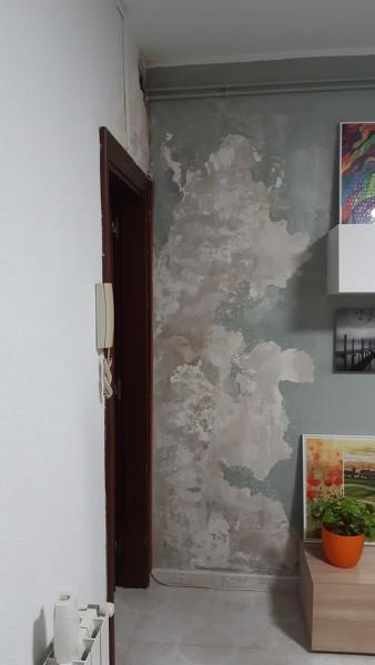 ¿Cuánto costaría arreglar una pared y las próximas a ella?