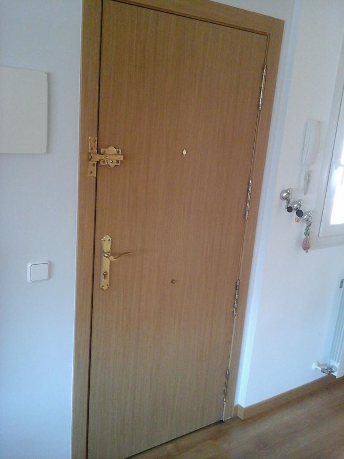 Cambio sentido apertura puerta blindada dehesa vieja for Puerta blindada casa