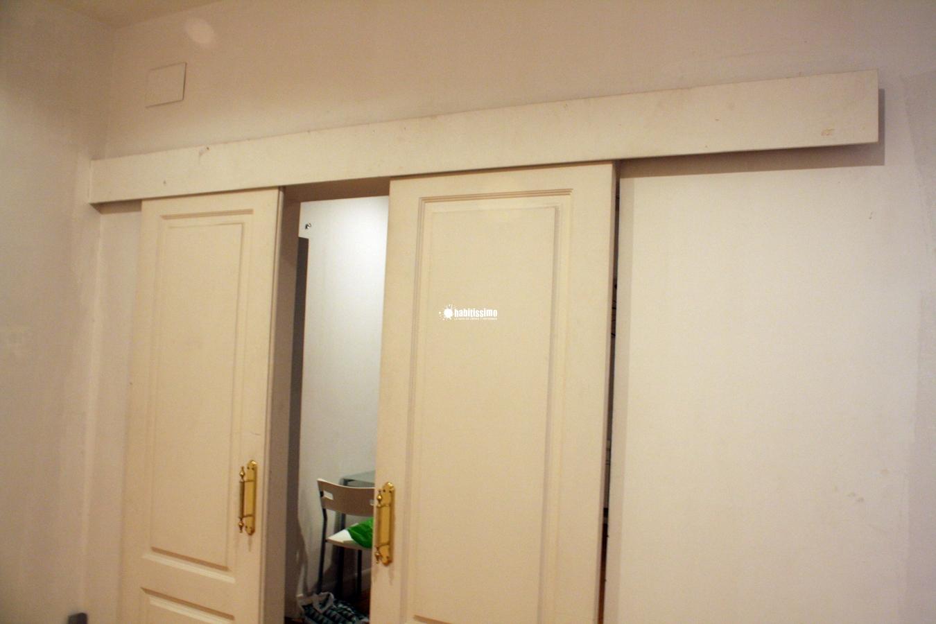 Cerrar y poner tope a puerta corredera de madera madrid - Como hacer puertas correderas ...