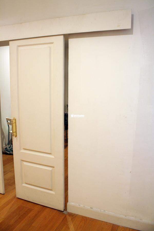 Cerrar y poner tope a puerta corredera de madera madrid for Puerta corrediza de madera