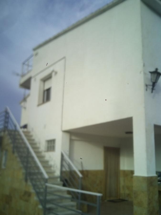 Reparar zonas de revoco en fachada casa y pintar castell - Presupuesto pintar casa ...