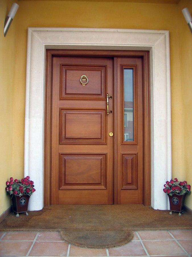Casa de este alojamiento instalar de puertas de entrada for Doble puerta entrada casa