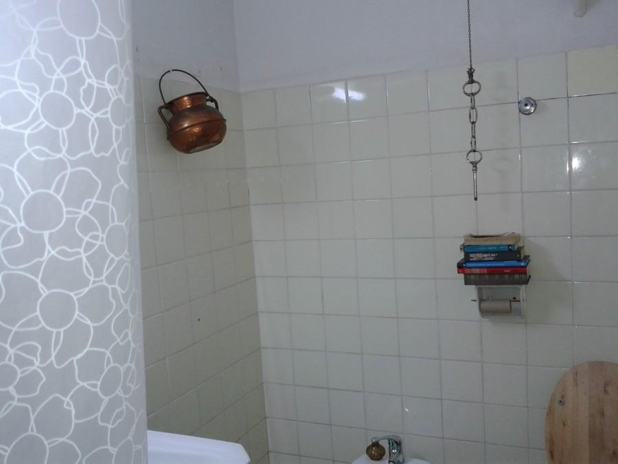 Reforma racholas en cocina y ba o cambio ba era a ducha for Racholas cocina