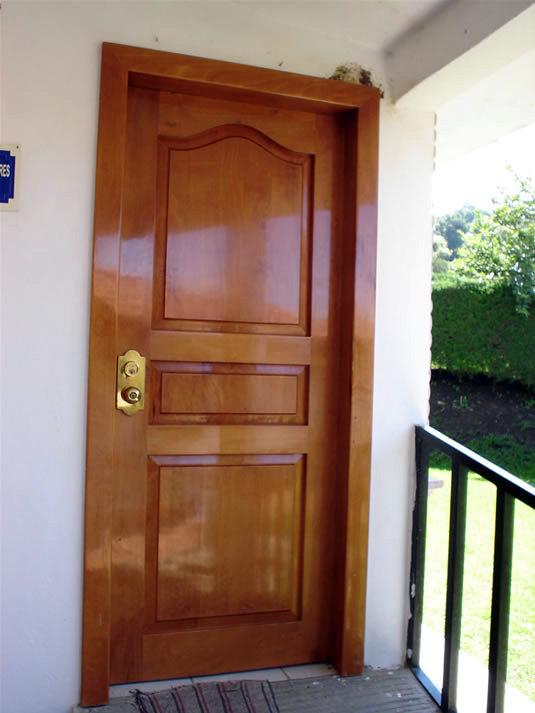 Instalar puerta en exterior a ca iza pontevedra for Precio puerta madera exterior